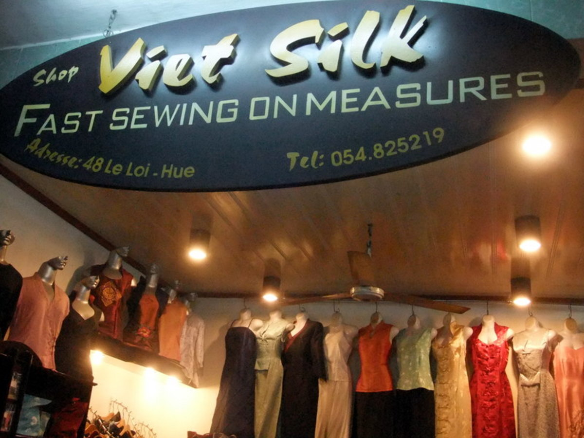 Tailoring is big business in Vietnam. Another poor translation that turned into a funny signange