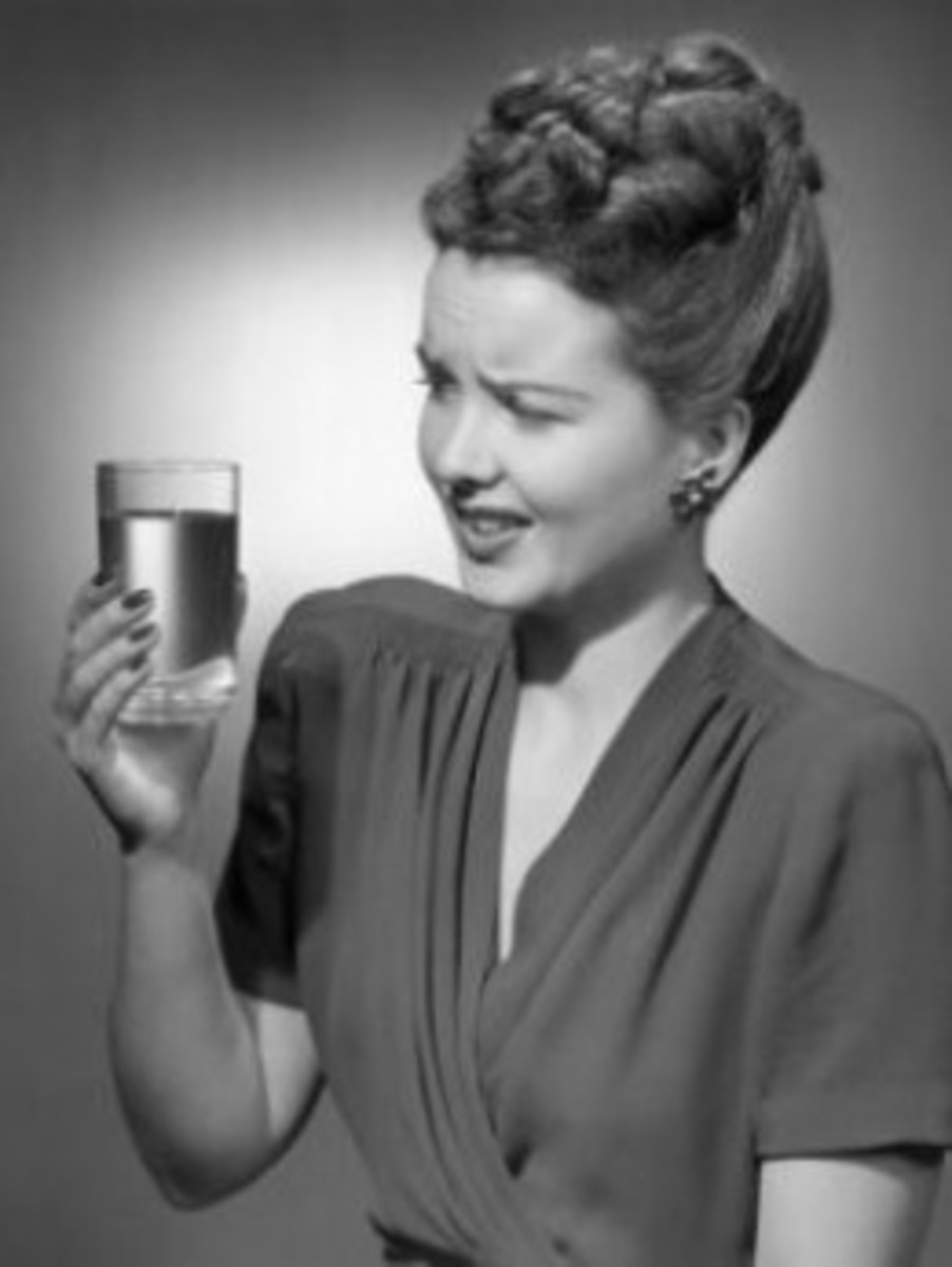 Woman Drinking Glass of Water With Look of Disgust by George Marks