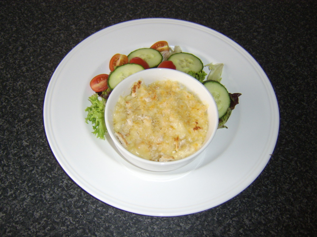 Penne pasta and large cod flakes stirred through a cheese sauce and topped with crispy breadcrumbs