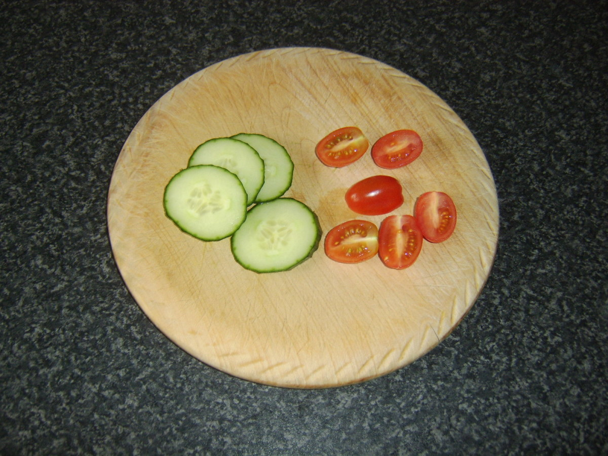 Tomato and cucumber form the garnish for the pasta along with some green salad leaves