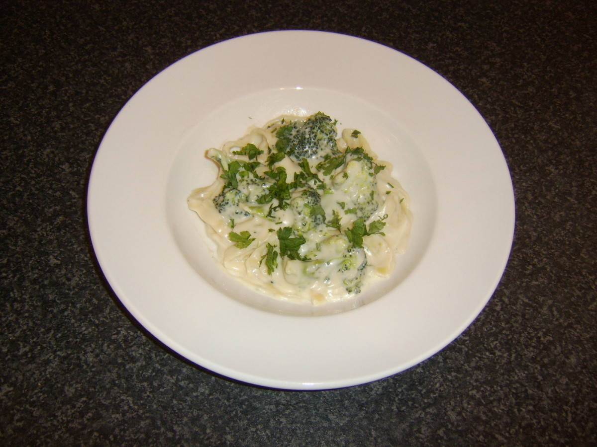 Tagliatelle pasta and broccoli florets are folded through a Stilton cheese based sauce