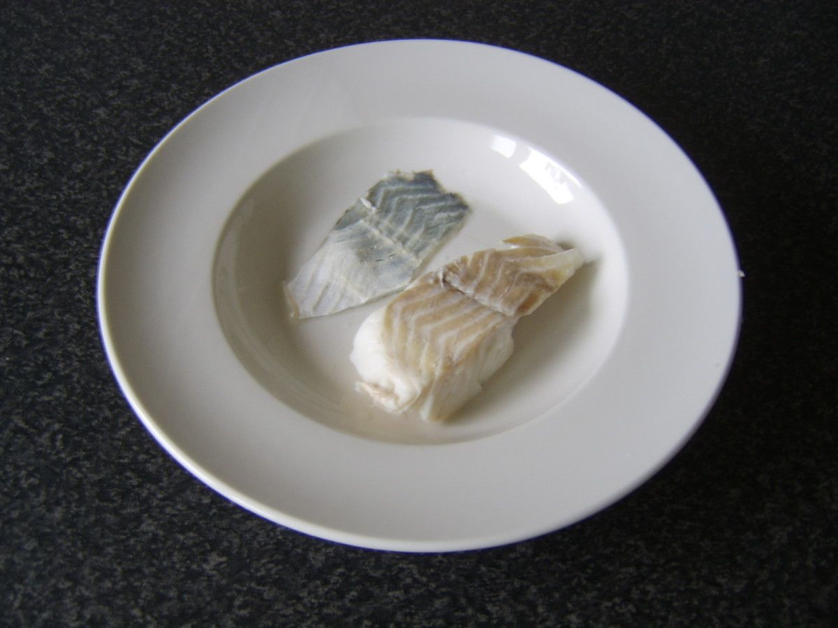 Skin is peeled from cooked and cooled cod before it is flaked