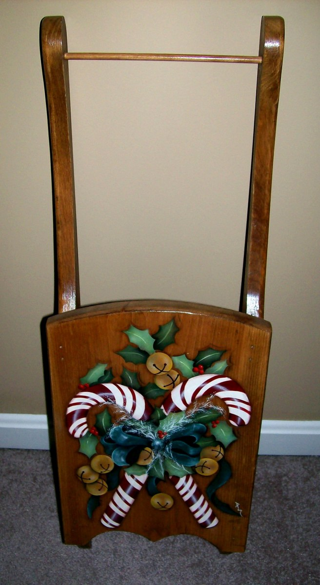 Christmas sled painted by Patty Sypek