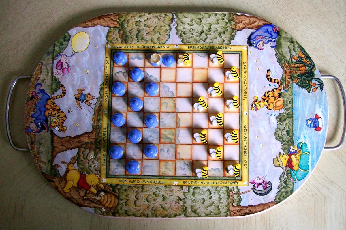 Winnie the Pooh & Friends checker board painted by Patty Sypek ~ she made this unique piece using the flip side of a wooden cutting board.  The moving pieces are little bumble bees and honey pots with removable lids.