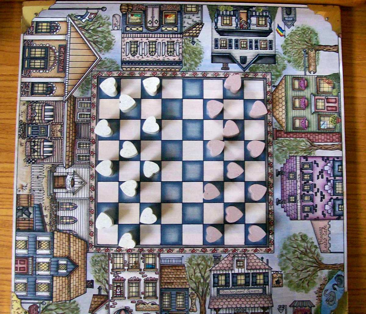 Another beautiful checker board with heart shaped movable pieces painted by Patty Sypek