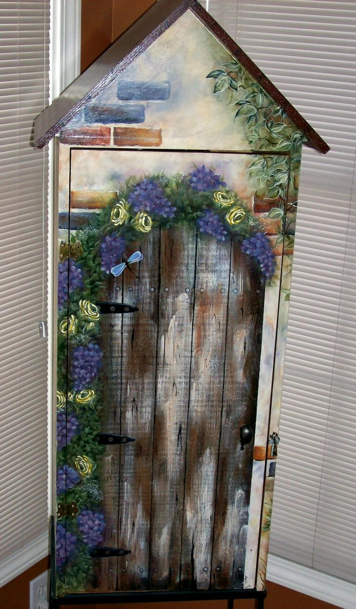 Decorative art storage cabinet painted by Patty Sypek/design by Fiona Hayward