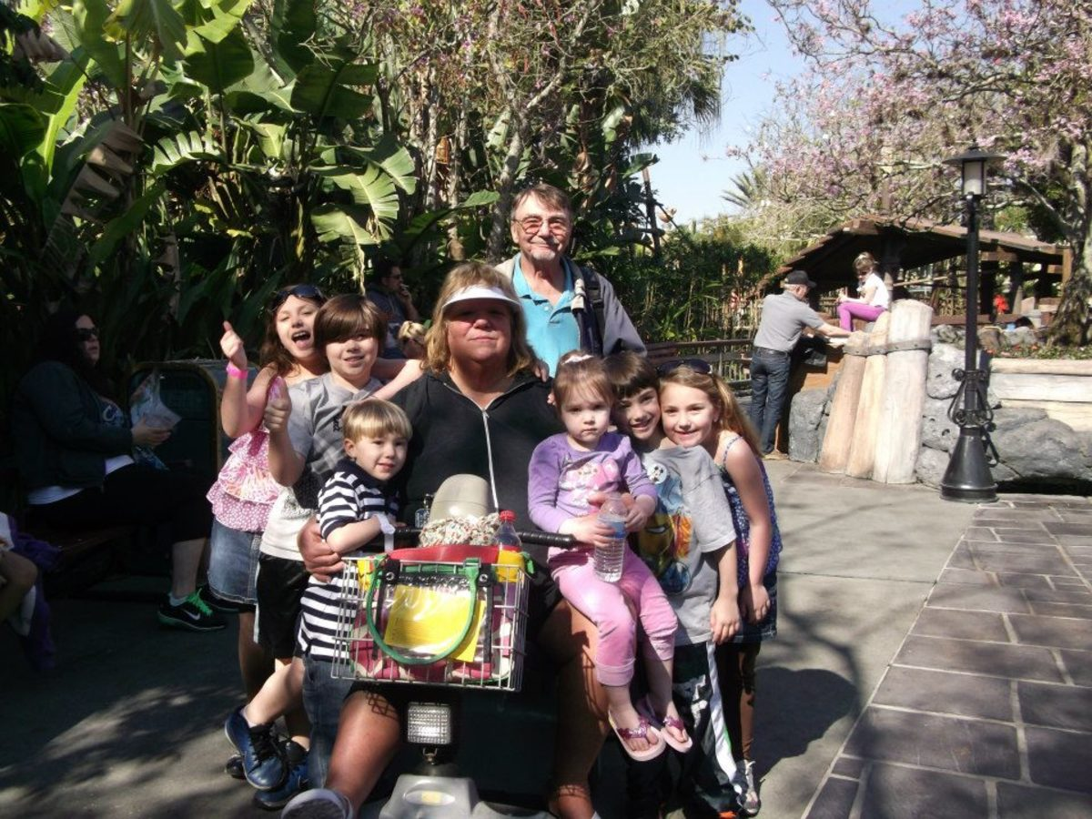 Magic Kingdom: Me and my scooter with hubby and six happy grandkids!