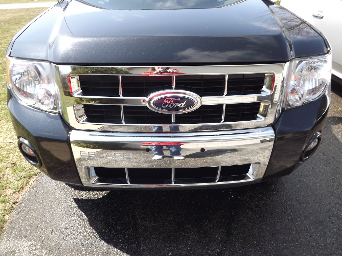 This is a chrome grill on an Escape. Many newer models have plastic grills.