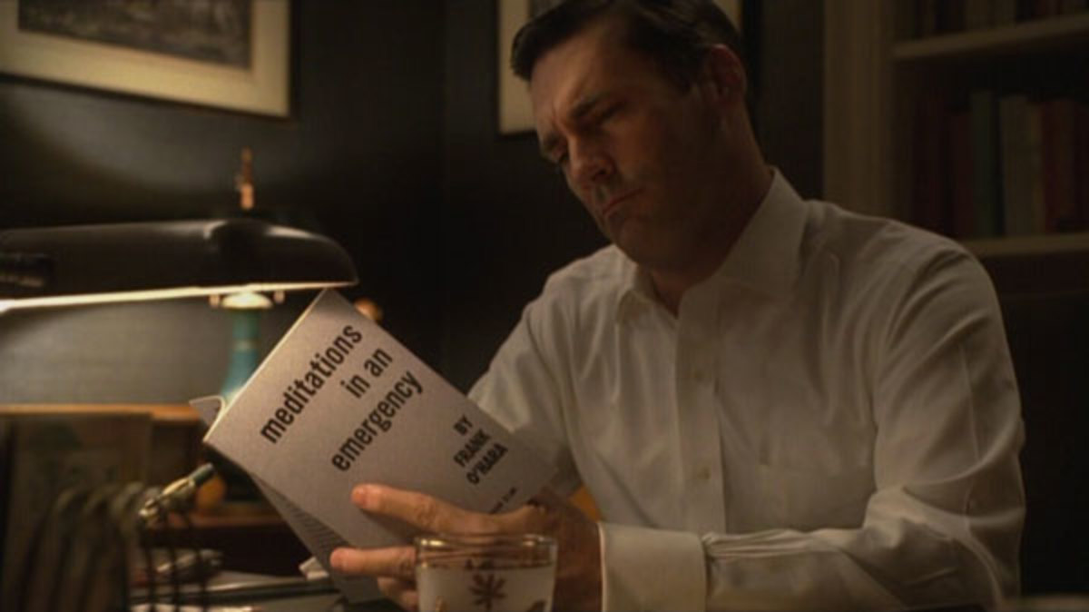 Don Draper reading and drinking, two of his favourite pastimes