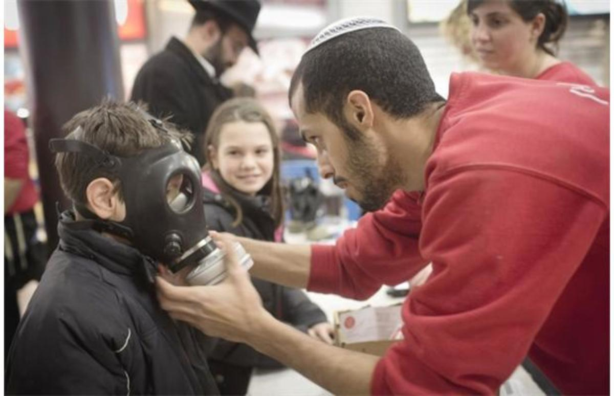 Israeli children receiving gas masks.