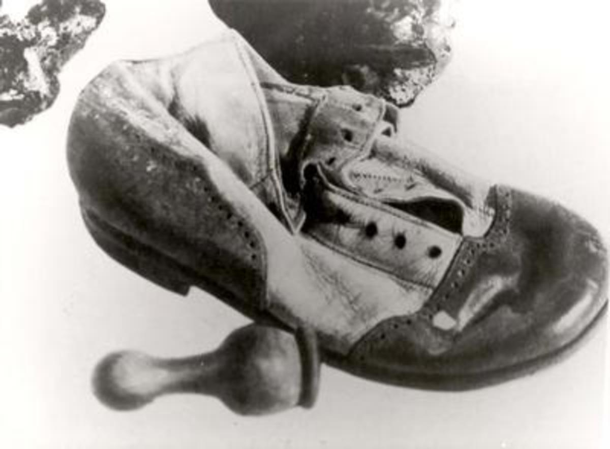 A child's shoe and chess piece found at Treblinka