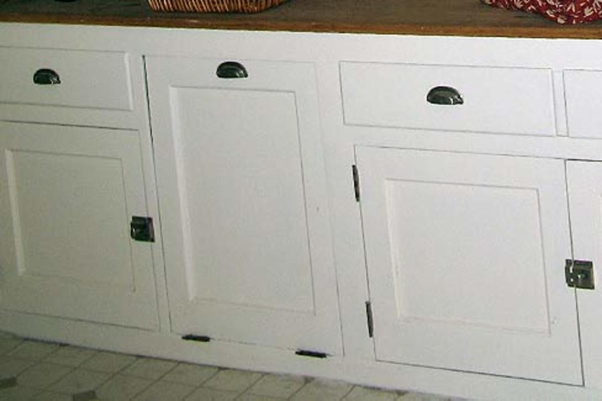 The way cabinets were made 100 yrs ago...note the latches and hinges