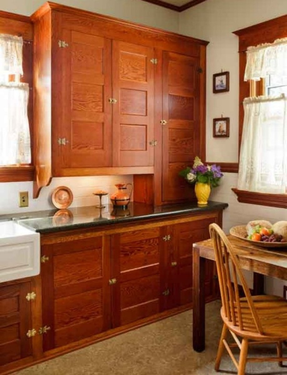 Absolutely flawless original vintage cabinets. Note the lack of toe space...continuous crown trim from cabinets to window, correct hinges and latches. These are original,  never painted, cabinets.