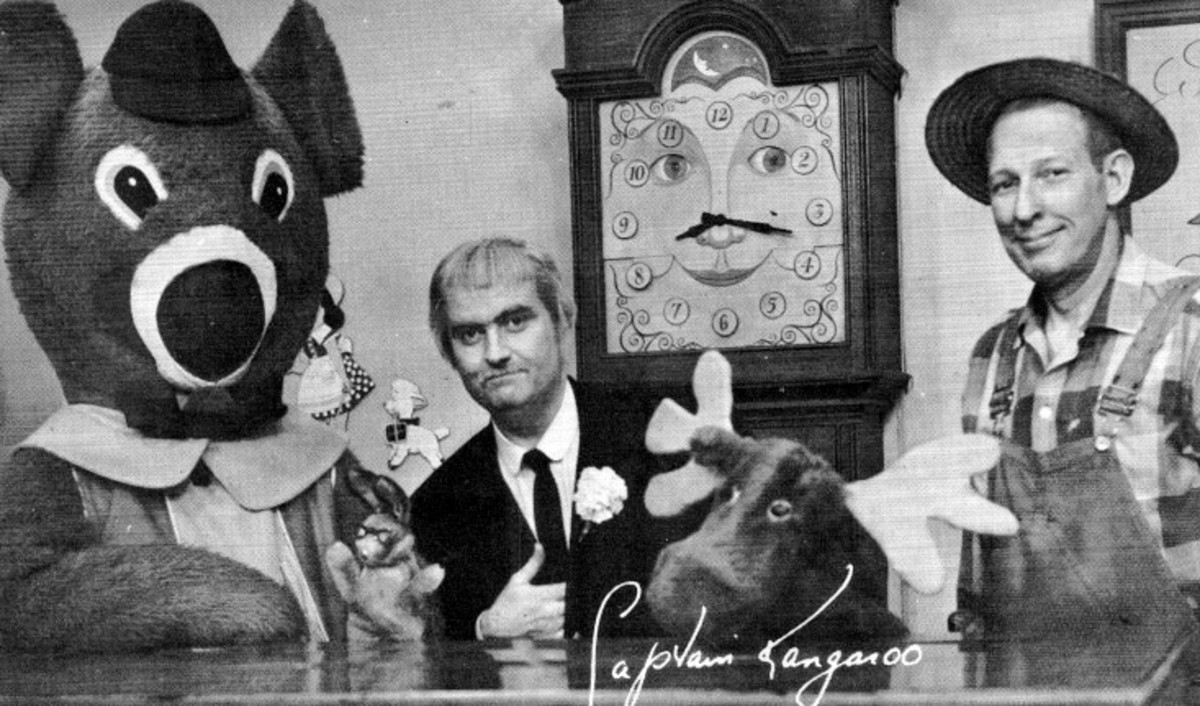Dancing Bear, Bunny Rabbit, the Captain, Mr. Moose, Mr. Green Jeans, and Grandfather Clock in the background.