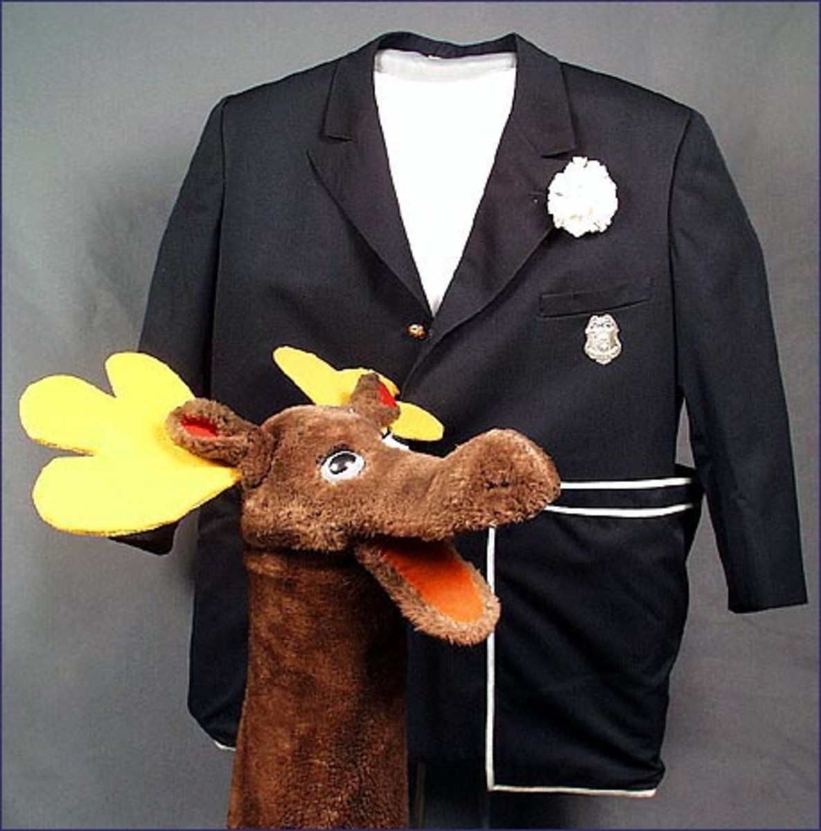 Mr. Moose at the Smithsonian Institution with one of the Captain's original jackets. In the 1980s, the jacket was a red one and in the late 1960s, the Captain wore jackets made of paper to show viewers a new cloth invented with paper.