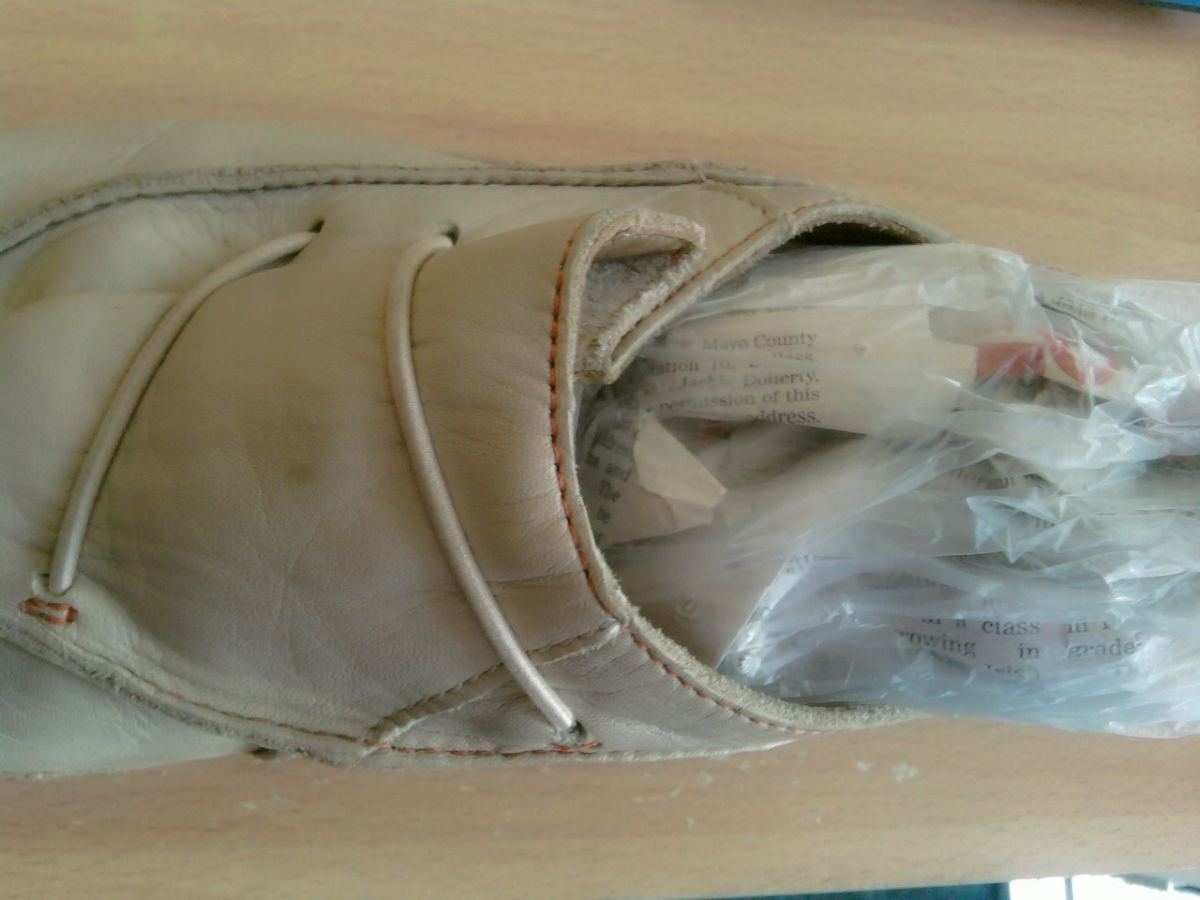 Once you've inserted the newspaper into the freezer bag, insert it into the shoe.