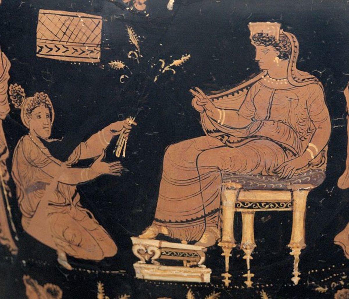 Demeter, enthroned and extending her hand in a benediction toward the kneeling Metaneirat (c.340 BC)