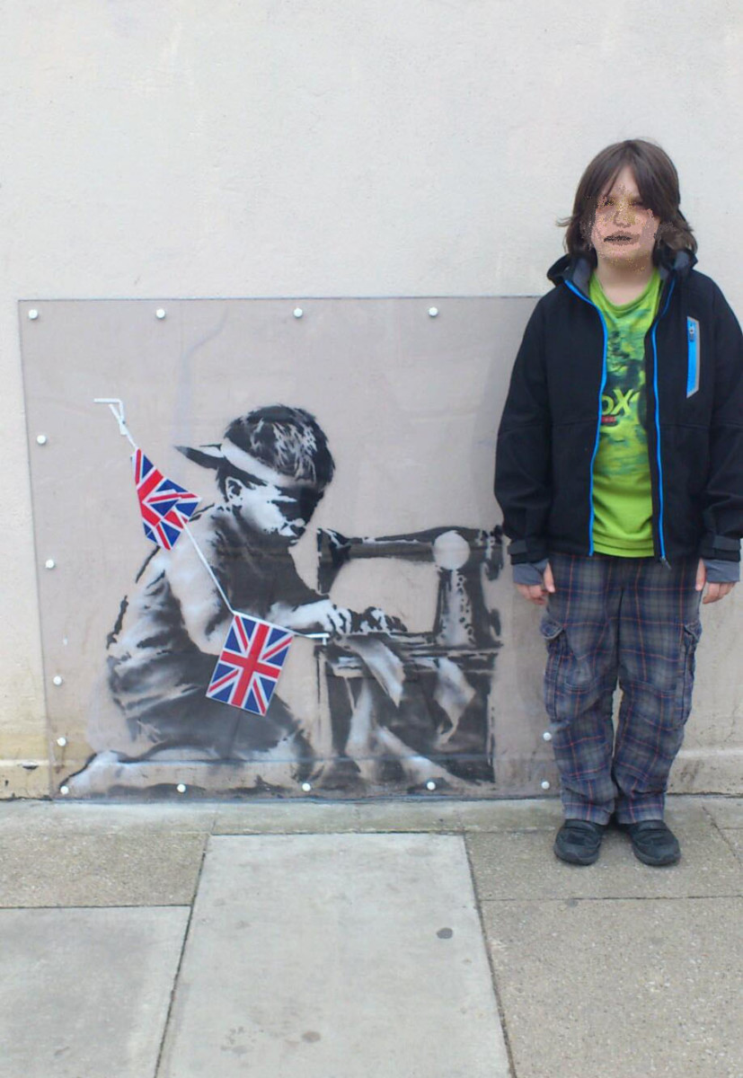 This was painted on the side of a cut-price superstore to underline the fact that we buy cheap clothes sourced from factories abroad that use child labour