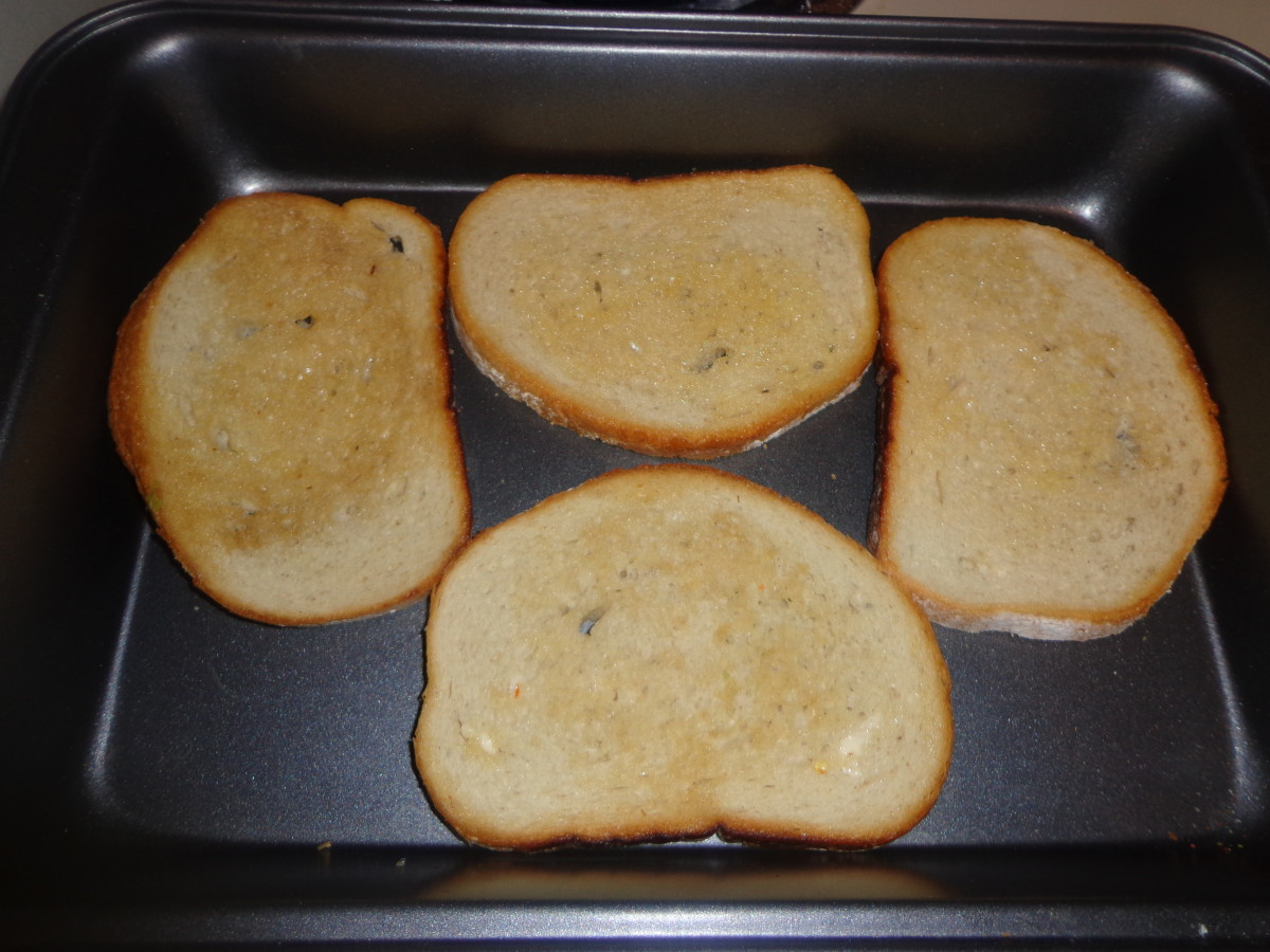 4 bread slices are greased and placed on a tray