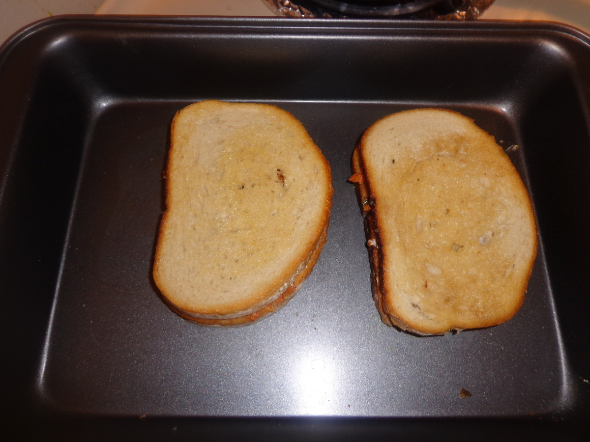 Place the other 2 bread slices on the filled bread slices