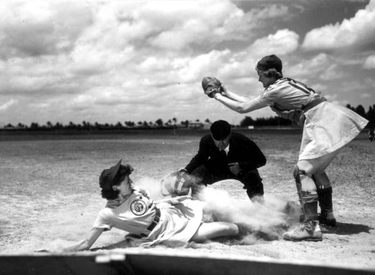 Members of the All-American Girls Professional Baseball League (AAGPBL) play it rough in a male sport. A 1948 shot of player Marge Callaghan sliding into home plate.