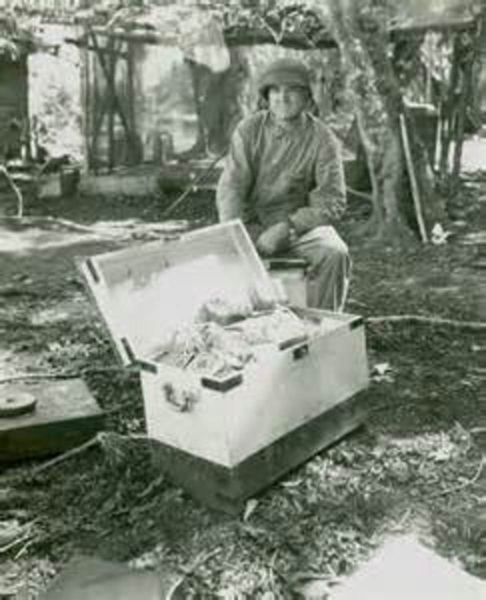Col. Goettge with captured Japanese currency. This is the last known photo taken of him.