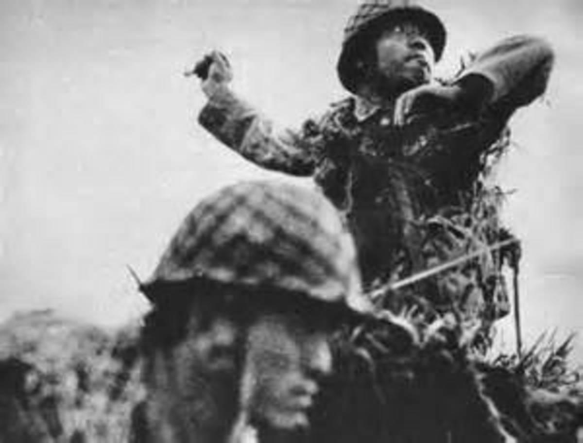 Japanese resist the advancing Marines.