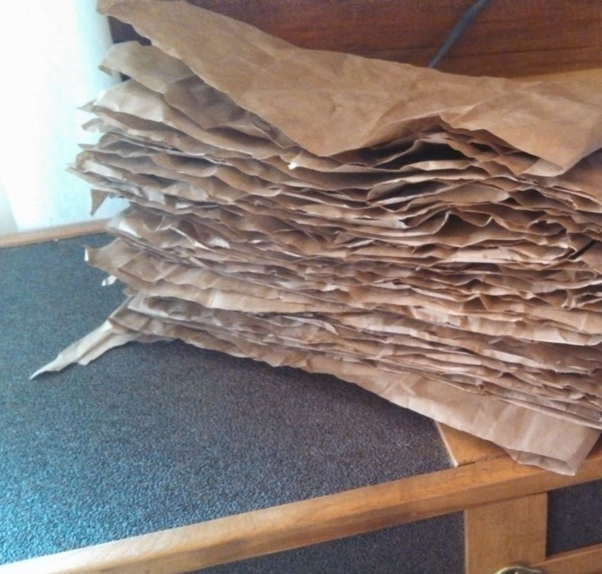 ... gets cut into sections, folded, and stacked neatly in the woodbox.