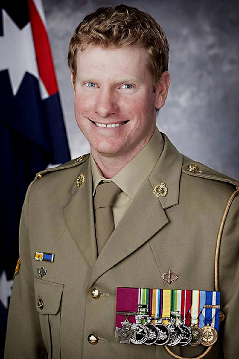 Australian Corporal Daniel Keighran VC. The Victoria Cross is the purple ribboned cross which can be seen on the left of this image