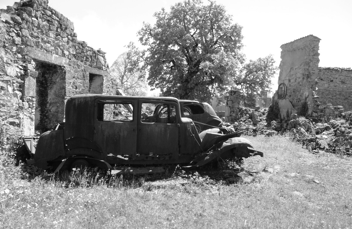 Burnt out cars left just as found on 10th June 1944.