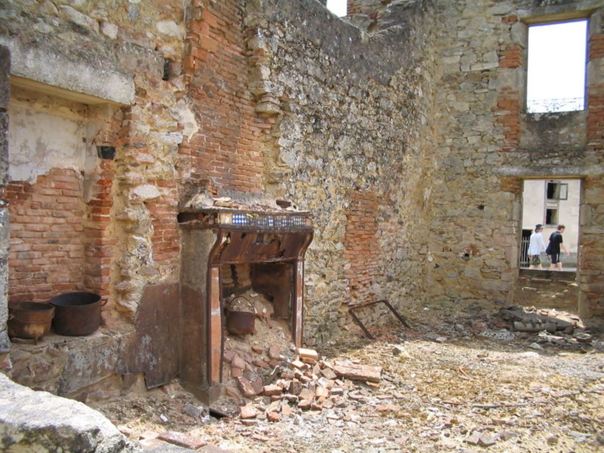 Pots and pans near the fireplace in this ruined house.