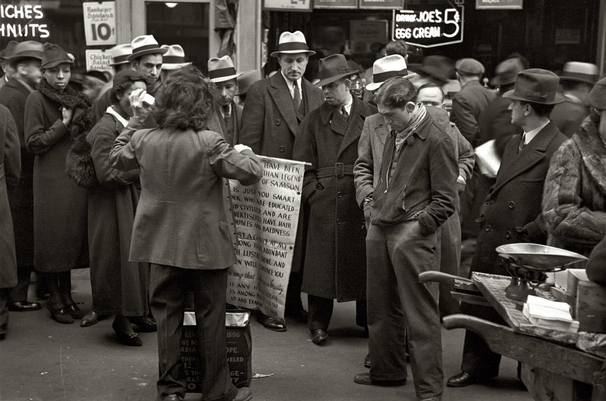 New York, November 1936. Hair tonic salesman advertising his wares 'Joe's Egg Cream', Seventh Avenue at 38th Street.