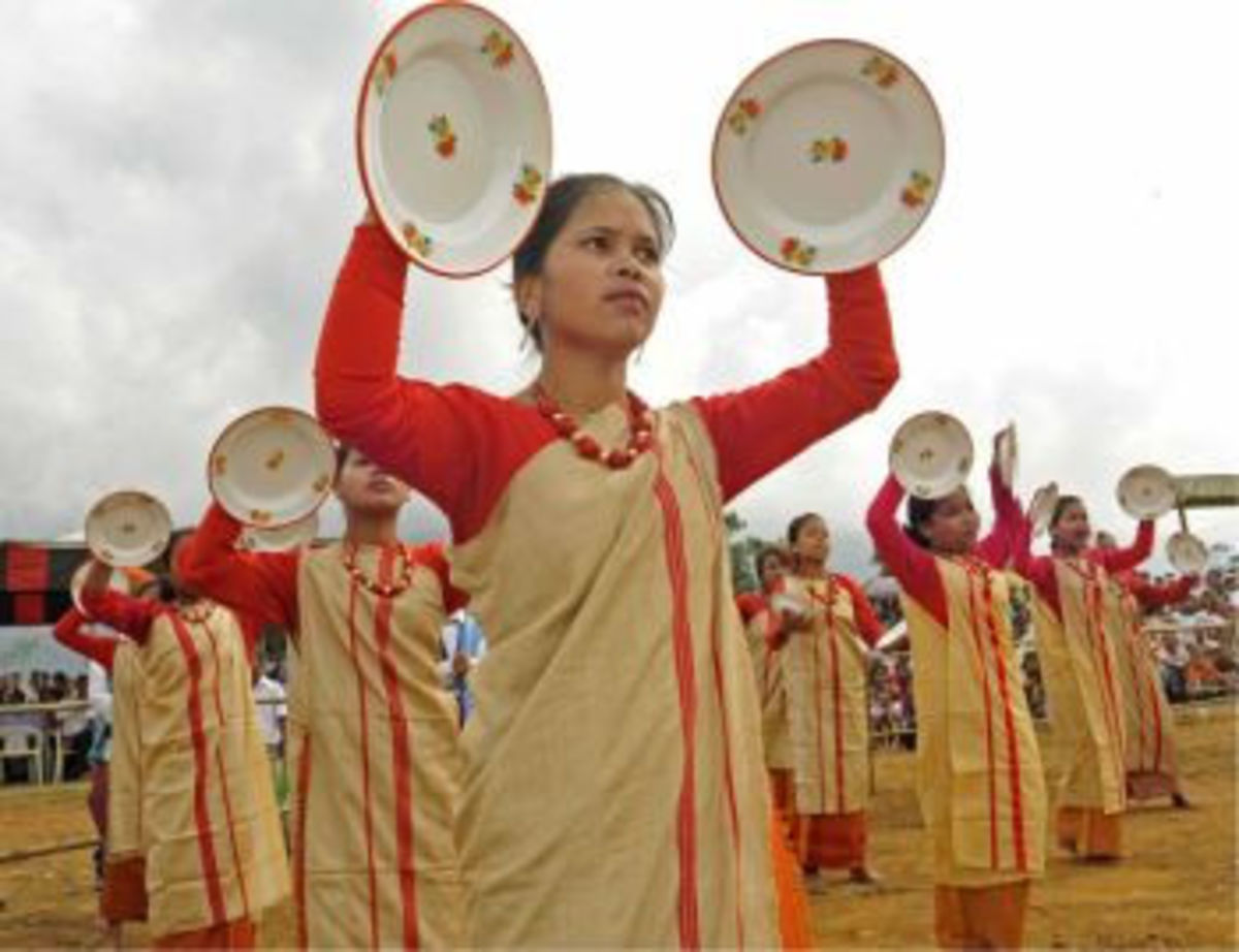 Jatinga girls perform the plate dance during the first International Jatinga Festival