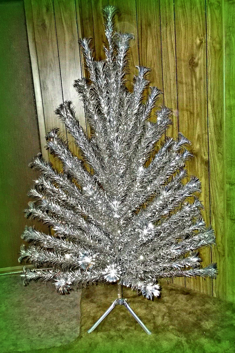 Vintage 6 foot Evergleam Aluminum Christmas Tree with 93 branches complete in sleeves with tripod stand,box, and original instructions.