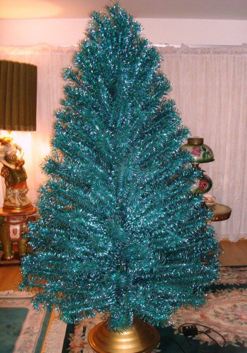 The vintage emerald green blue seven foot stainless aluminum Holiday Christmas tree. This is a most have for a true vintage tree lover.