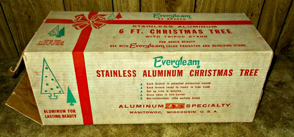 Has the original instruction sheet and a store advertising hang card, as it was used as a floor display.  That is probably the only time this beautiful Silver Aluminum Christmas Tree was ever used.
