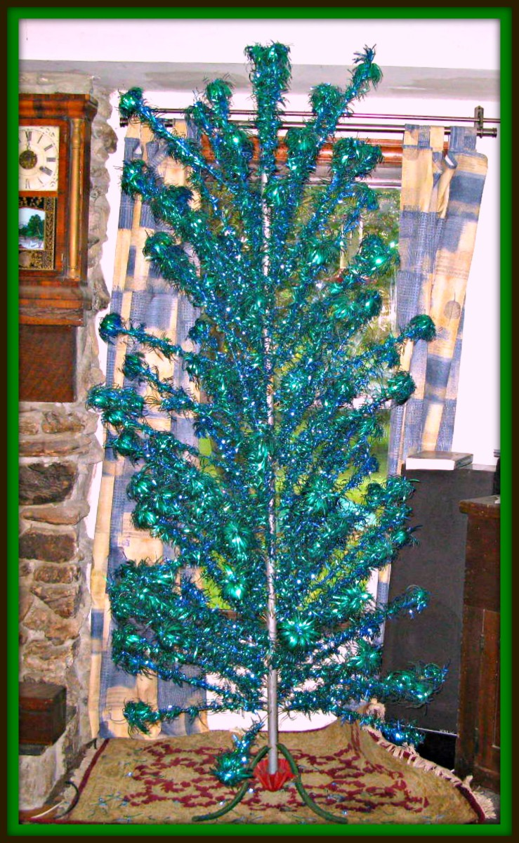 This tree is 92 inches tall from the bottom of the stand to the top of  tree with small branch that sticks in top.  There are 114 branches. Pom Pom Silver Forest Aluminium Christmas Tree 7 1/2'  beautiful blue and green colors ...