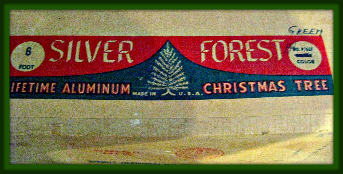 The box for the Pom Pom Silver Forest Aluminum Christmas Tree 7 1/2' Blue & Green 114 Branches, and made in the USA back in the glorious early 1960s.
