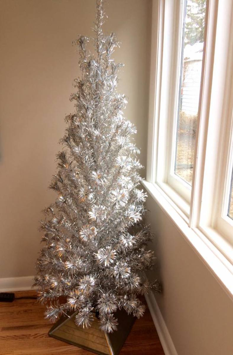 """An early 1960s beauty, the Evergleam 121 branch """"Slim Line"""" model aluminum tree I own. I think it looks good enough to leave with out decorations, this model was made for folks with limited space, such as apartment dwellers, and is very well made."""