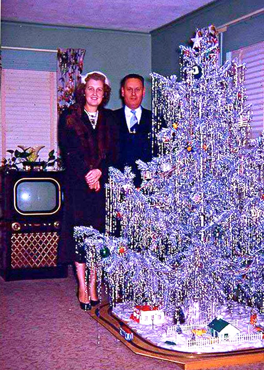 Have a bit of tinsel baby, the first Aluminum Christmas Tree in 1959, count down to the 1960s space age just began, things are starting to change.