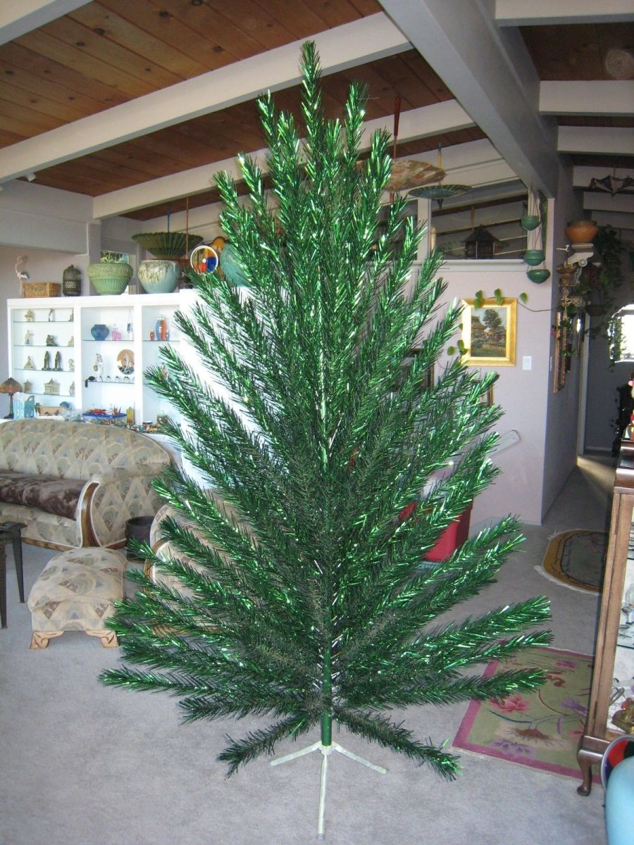 A vintage Evergleam green 8FT. taper Christmas tree with 124 branches. The condition is as good as we have ever seen on one of these aluminum trees.
