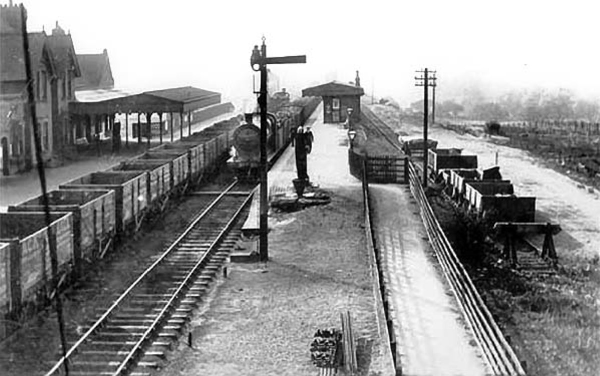 A train of coal empties pass South Cave station on the H&BR on the way south-west to the southern area of the widespread Yorkshire Coalfield