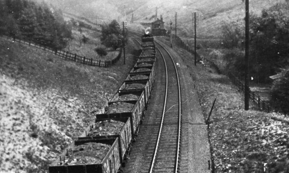 Laden coal wagons pass Weedley on the way to Hull docks for export to the Continent  - a large amount of coal traffic went this way from the old West Riding collieries (now South Yorkshire, incorporating Sheffield and Doncaster as the main towns)