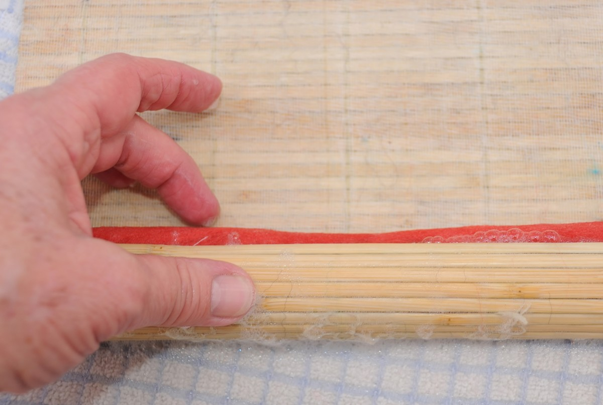 Placing the roll in the sushi mat