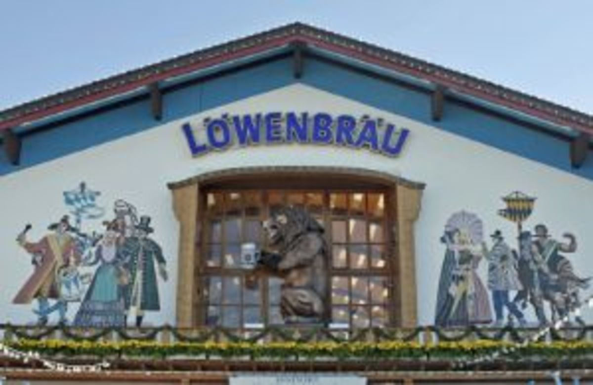 "Lowenbrau Beer Tent where I hung out at the Oktoberfest.  Great beer.  Above the entrance is the mighty lion which roars ""Loooooenbrau"" every few minutes."