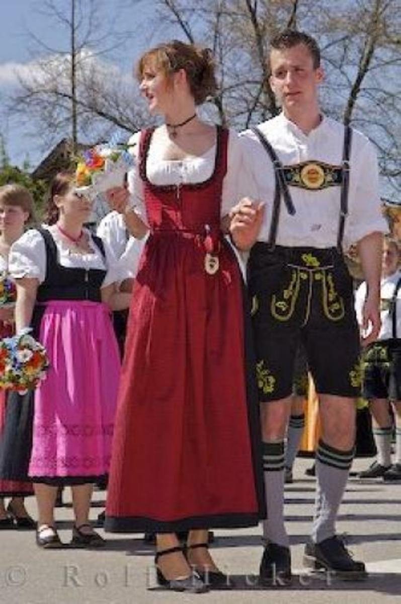 German traditional dress.  Dirndls for the women and lederhosen for the men.