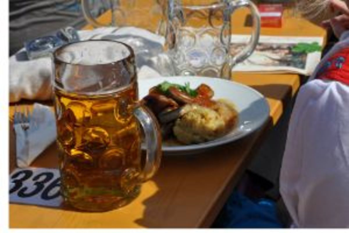 Litre of beer with wurst food served at the Oktoberfest.