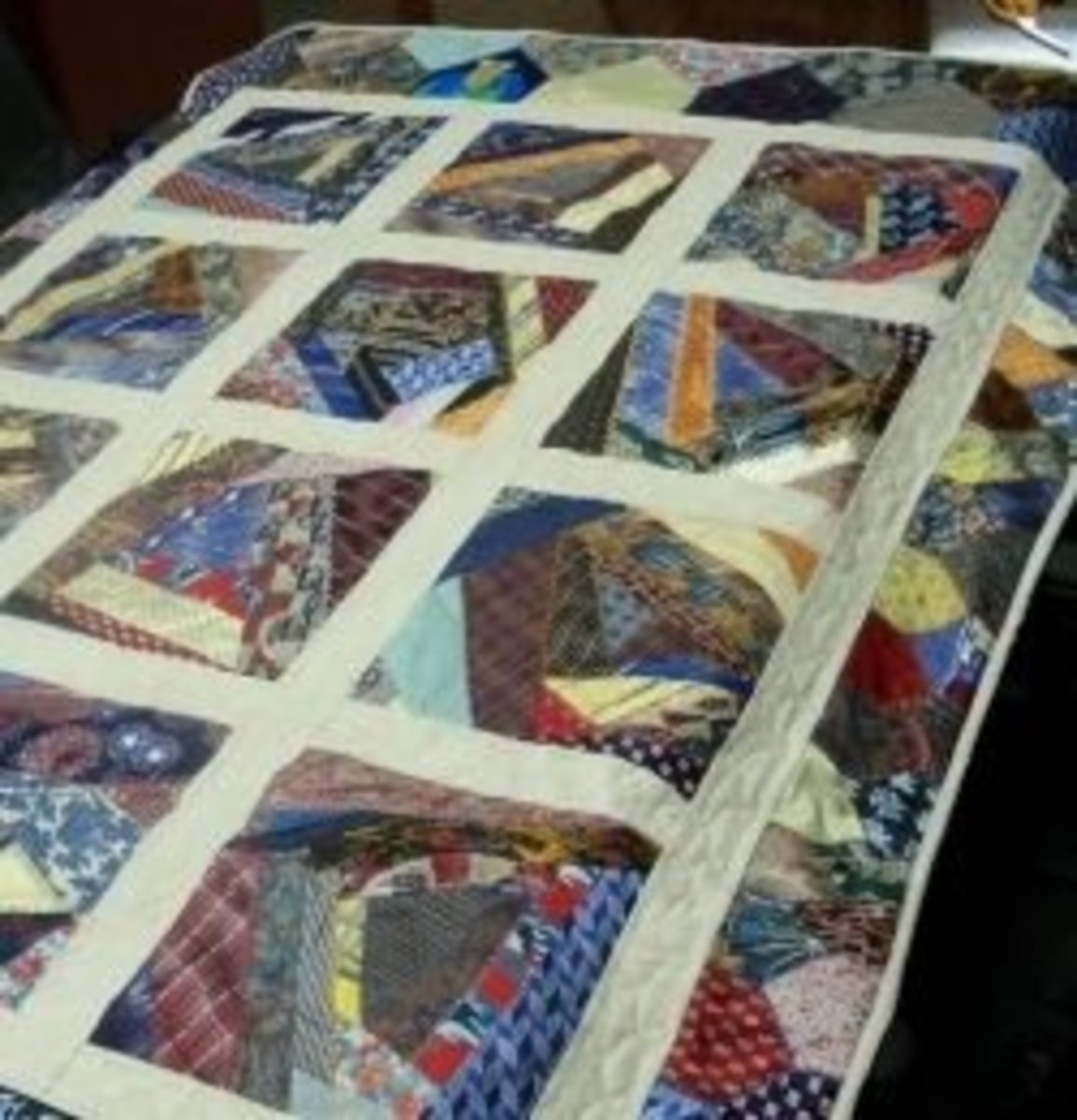 Crazy quilting is my absolute favorite kind of quilting and it makes for hours of fun simply looking at how the patterns (or lack of patterns) come together. This crazy quilt is a very fun use of neckties, made more crazy with a variety of patterns.