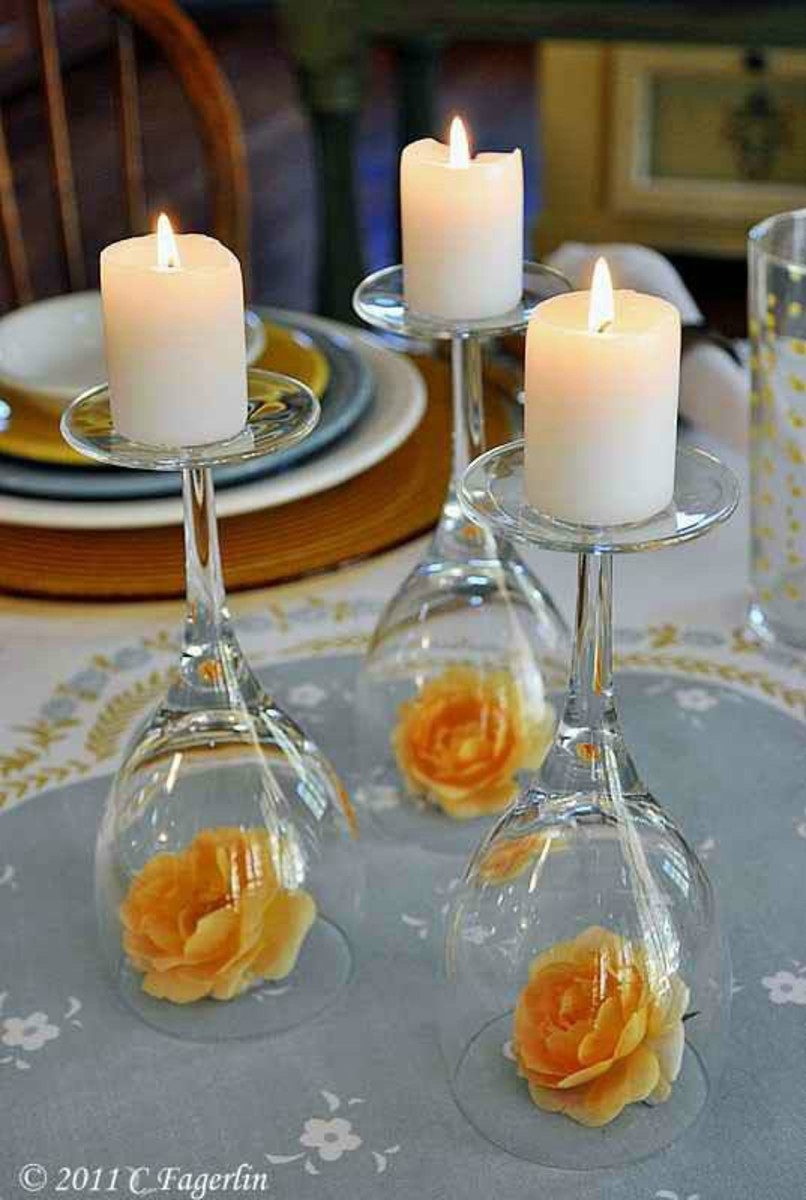 Candles, glasses and flower centre piece