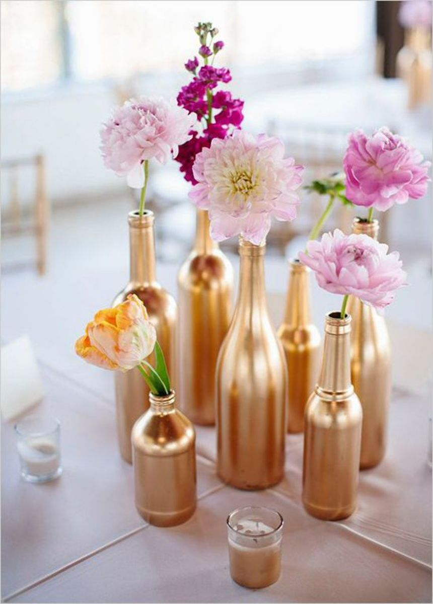 Wedding Table Decoration with gold painted bottles and Flowers